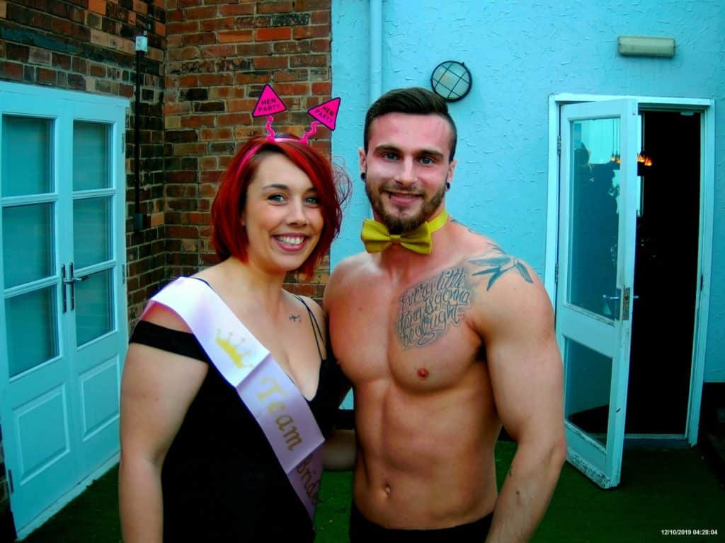 A buff butler with a guest at a hen party