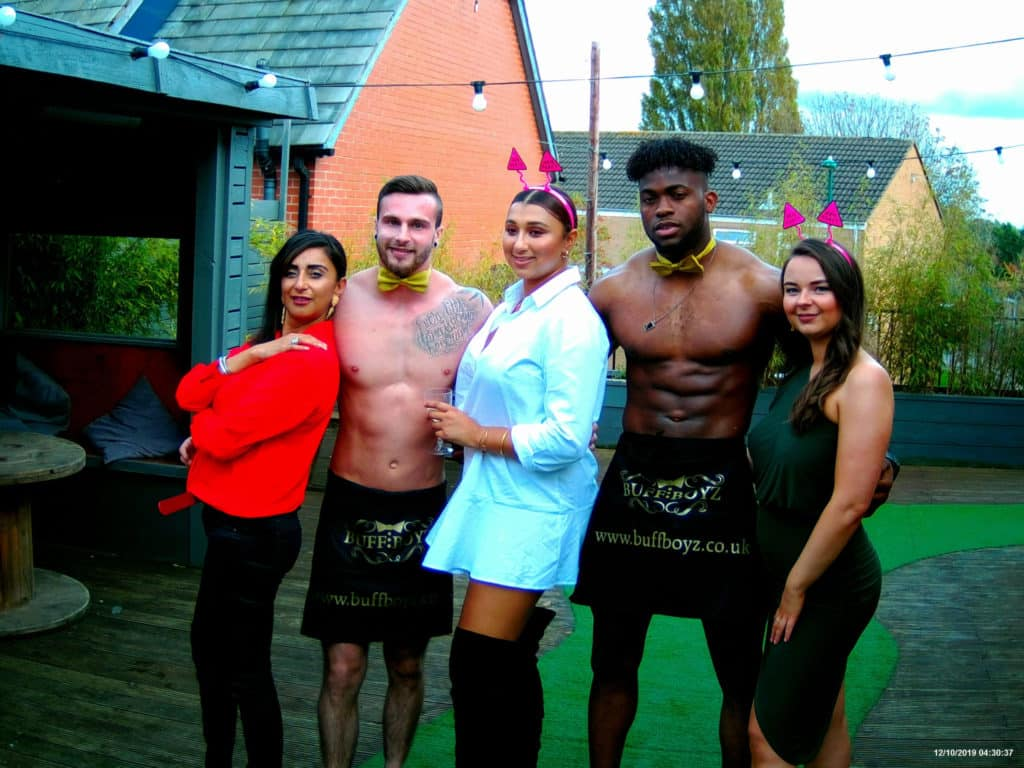 naked butlers with guests at a hen party weekend